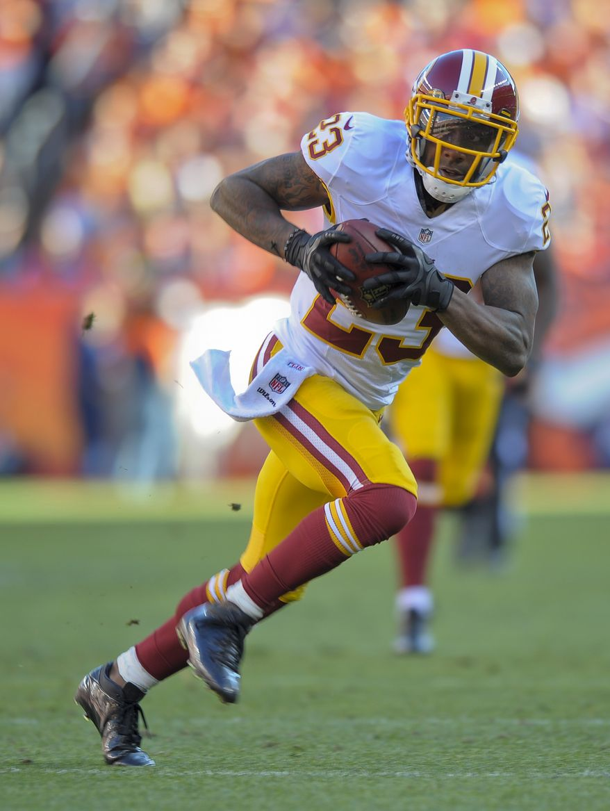 Washington Redskins cornerback DeAngelo Hall (23) runs back an interception fora touchdown against the Denver Broncos in the third quarter of an NFL football game, Sunday, Oct. 27, 2013, in Denver. (AP Photo/Jack Dempsey)