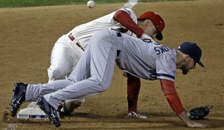 St. Louis Cardinals' Allen Craig gets tangled with Boston Red Sox's Will Middlebrooks during the ninth inning of Game 3 of baseball's World Series Saturday, Oct. 26, 2013, in St. Louis. Middlebrooks was called for obstruction on the play and Craig went in to score the game-winning run. The Cardinals won 5-4 to take a 2-1 lead in the series. (AP Photo/David J. Phillip)