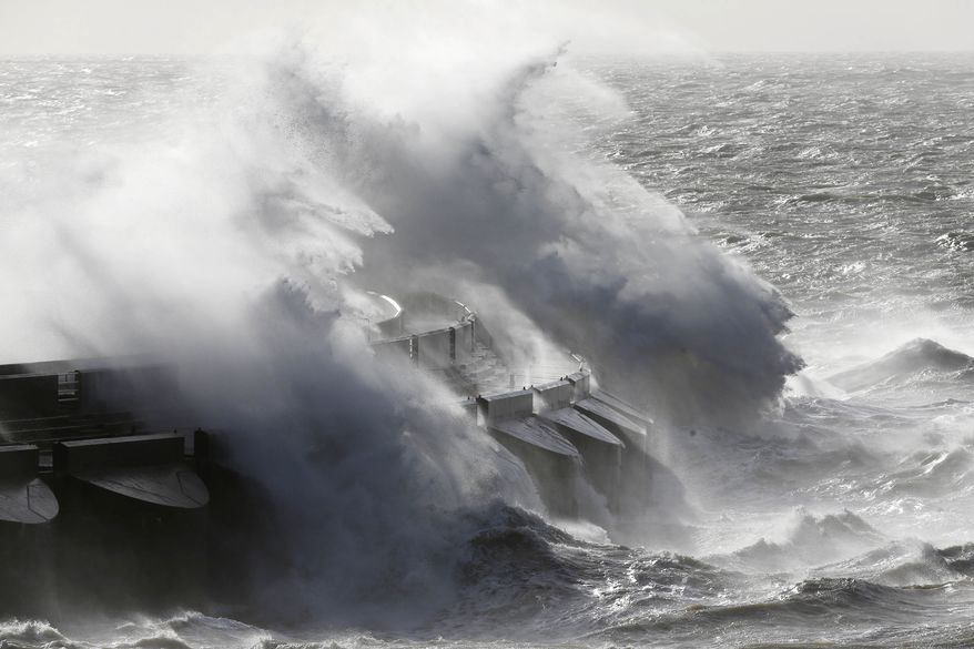 Waves batter into the sea wall of a marina in Brighton, south England, Monday, Oct. 28, 2013. A major storm with hurricane force winds is lashing much of Britain, causing flooding and travel delays including the cancellation of roughly 130 flights at London's Heathrow Airport. Weather forecasters say it is one of the worst storms to hit Britain in years. (AP Photo/Sang Tan)