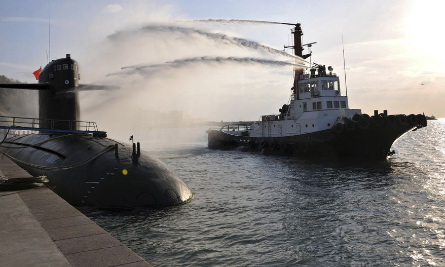 In this photo taken on Oct. 26, 2010, and released by the Chinese Navy on Sunday, Oct. 27, 2013, a Chinese navy nuclear submarine takes part in a nuclear safety drill at the Qingdao submarine base in east China's Shandong province. In a sign of growing confidence, China's navy gave Chinese media on Sunday unprecedented publicity on its first nuclear submarine fleet, one of its most secretive military programs. China is devoting increasing resources to its naval forces to safeguard its maritime interests and assert its territorial claims. (AP Photo)
