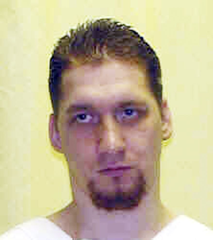 Ronald Phillips is scheduled to be executed at the Southern Ohio Correctional Facility in Lucasville, Ohio, on Nov. 14 for the rape and killing of his girlfriend's 3-year-old daughter in 1993. The state plans to use an untried dose of two drugs for the lethal injection. (AP Photo/Ohio Department of Corrections)