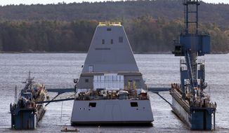 The first-in-class Zumwalt, the largest U.S. Navy destroyer ever built, floats off a submerged dry dock in the Kennebec River, Monday, Oct. 28, 2013, in Bath, Maine.  Unlike warships with towering radar- and antenna-laden superstructures, the Zumwalt will ride low to the water to minimize its radar signature, making it stealthier than others. (AP Photo/Robert F. Bukaty)