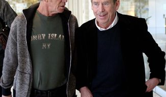 """Lou Reed (left), former frontman of the U.S. band """"Velvet Underground,"""" speaks with former Czech Republic President Vaclav Havel, who was a big fan. (Associated Press)"""