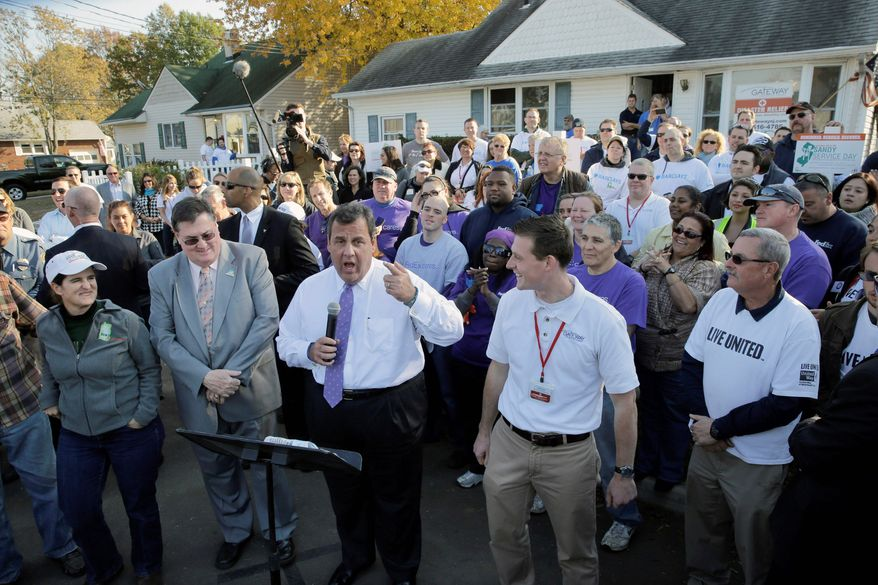 ** FILE ** In this Oct. 29, 2013, file photo, New Jersey Gov. Chris Christie speaks at the Superstorm Sandy-damaged home of John and Angela Ciangiotto in Union Beach on the one-year anniversary of the storm. (Associated Press)