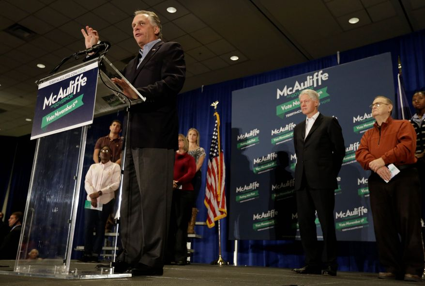 Virginia Democratic gubernatorial candidate Terry McAuliffe blasted his Republican opponent for not backing renewal of the Violence Against Women Act during a rally at James Madison University in Harrisonburg, Va. on Tuesday with former President Bill Clinton. (Associated Press)