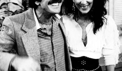 "1960's pop singers Sonny and Cher share a laugh during a taping of ABC's ""Good Morning America"" in New York City on Oct. 3, 1981.  (AP Photo/David Handschuh)"