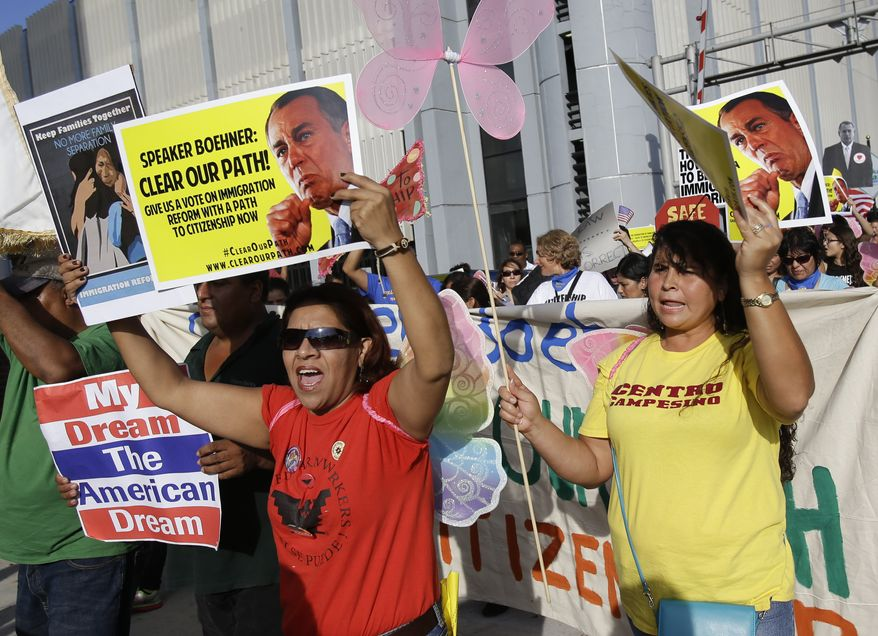 Immigration reform advocates march and rally through the downtown streets , Tuesday, Oct. 29, 2013, in Orlando, Fla. The march and rally was to support passage of a pathway-to-citizenship bill for immigration reform. (AP Photo/John Raoux)