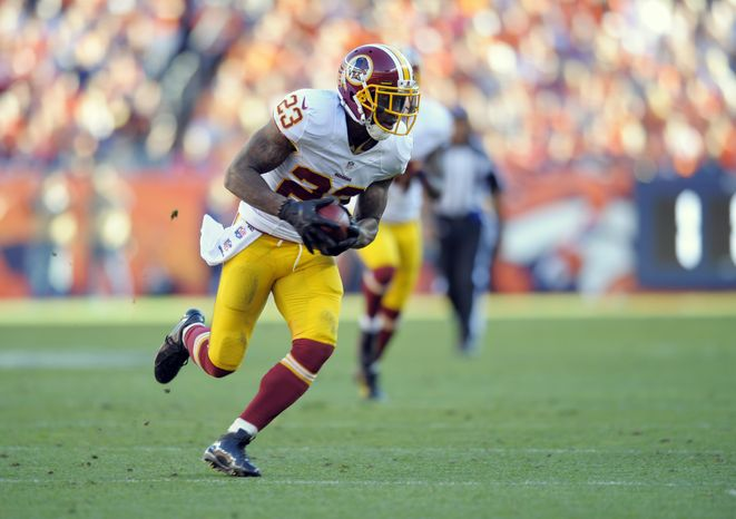 Washington Redskins cornerback DeAngelo Hall runs an interception back for a touchdown against the Denver Broncos during an NFL football game Sunday, Oct. 27, 2013, in Denver. (AP Photo/Jack Dempsey)