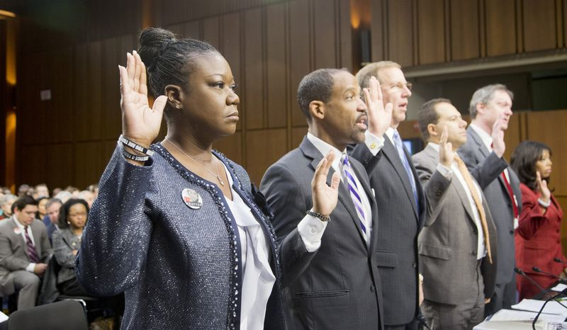 """Witnesses, from left, Sybrina Fulton, mother of Trayvon Martin; Ronald S. Sullivan, Jr., Clinical Professor of Law, Director of the Criminal Justice Institute, Harvard Law School; David LaBahn, Association of Prosecuting Attorneys president and CEO; Ilya Shapiro, Senior Fellow in Constitutional Studies at Cato Institute; John R. Lott, Jr., president, Crime Prevention Research Center of Swarthmore, Pa.; and Lucia McBath of Atlanta, Ga.; are sworn in on Capitol Hill in Washington, Tuesday, Oct. 29, 2013, prior to testifying before a Senate Judiciary subcommittee hearing on so-called """"stand your ground laws.""""      (AP Photo/Manuel Balce Ceneta)"""