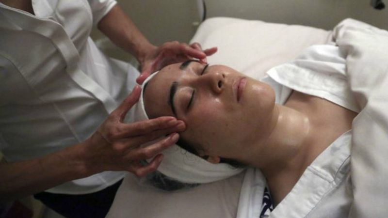 ** FILE ** A customer receives a luxury facial at a spa in New York. (AP Photo/Mary Altaffer)