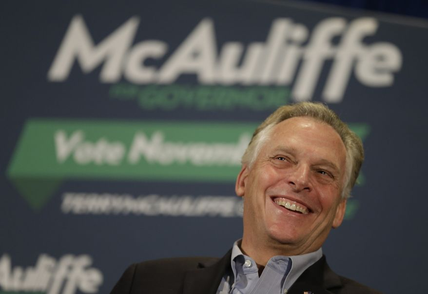 Virginia Democratic gubernatorial candidate, Terry McAuliffe smiles as he listens to former President Bill Clinton during a rally at James Madison University in Harrisonburg, Va., Tuesday, Oct. 29, 2013. Clinton has attended rallies around the state to give his support to McAuliffe.   (AP Photo/Steve Helber)
