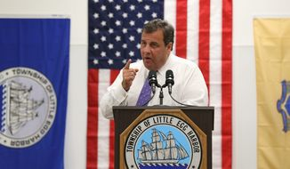 New Jersey Gov. Chris Christie marks the one-year anniversary of Superstorm Sandy at the reopening of the community center in Little Egg Harbor, N.J., on Tuesday. The center was flooded and heavily damaged during the storm and through grass-roots funding and donations, the township repaired it. (THE PRESS OF ATLANTIC CITY via ASSOCIATED PRESS)