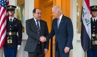 Vice President Joseph R. Biden welcomes Iraqi Prime Minister Nouri al-Maliki to the Naval Observatory. (Associated Press)