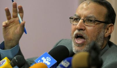 ** FILE ** Essam el-Erian, a senior Muslim Brotherhood leader seen speaking in Cairo on Feb. 2, 2011. (Associated Press)