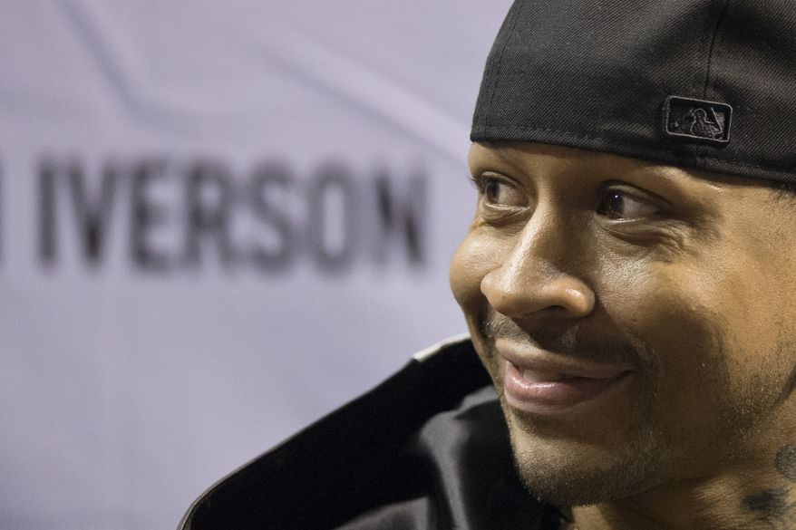 Former Philadelphia 76ers basketball player Allen Iverson smiles during a news conference Wednesday, Oct. 30, 2013, in Philadelphia. Iverson officially retired from the NBA, ending a 15-year career during which he won the 2001 MVP award and four scoring titles. Iverson retired in Philadelphia where he had his greatest successes and led the franchise to the 2001 NBA finals. (AP Photo/Matt Rourke)
