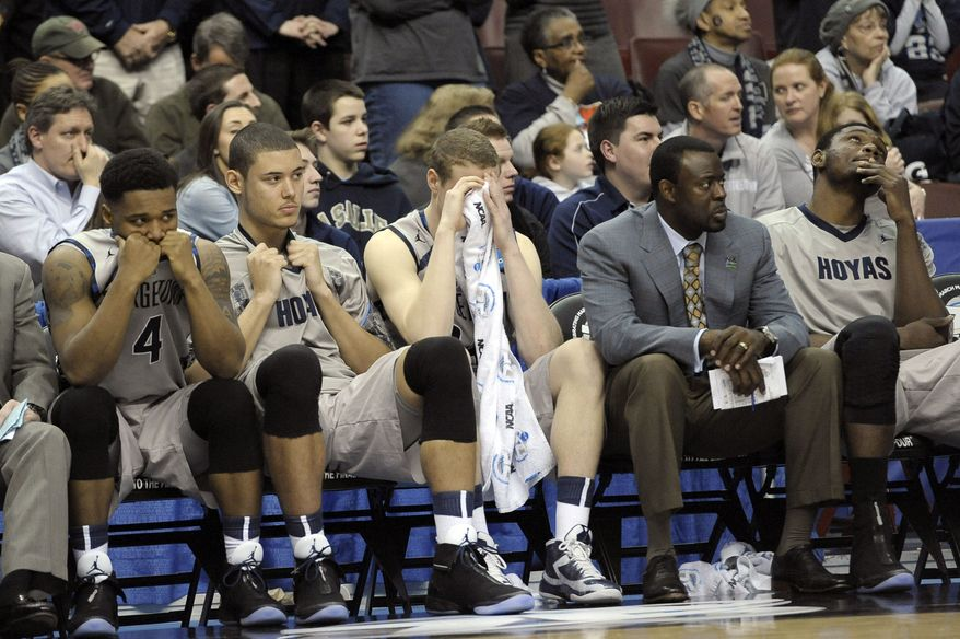 Georgetown players and personnel react on the bench in the final minutes of a second-round game against Florida Gulf Coast in the NCAA college basketball tournament on Friday, March 22, 2013, in Philadelphia. Florida Gulf Coast won 78-68. (AP Photo/Michael Perez)
