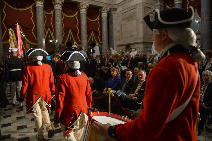 Members of the United States Army Old Guard Fife and Drum Corps perform at the beginning of a dedication ceremony for a bust of former British Prime Minister Sir Winston Churchill in Statuary Hall of the U.S. Capitol Building, Washington, D.C., Wednesday, October 30, 2013. The bust was authorized and passed by the House of Representatives shortly before the 70th anniversary of Churchill's wartime address to a joint meeting of Congress. (Andrew Harnik/The Washington Times)