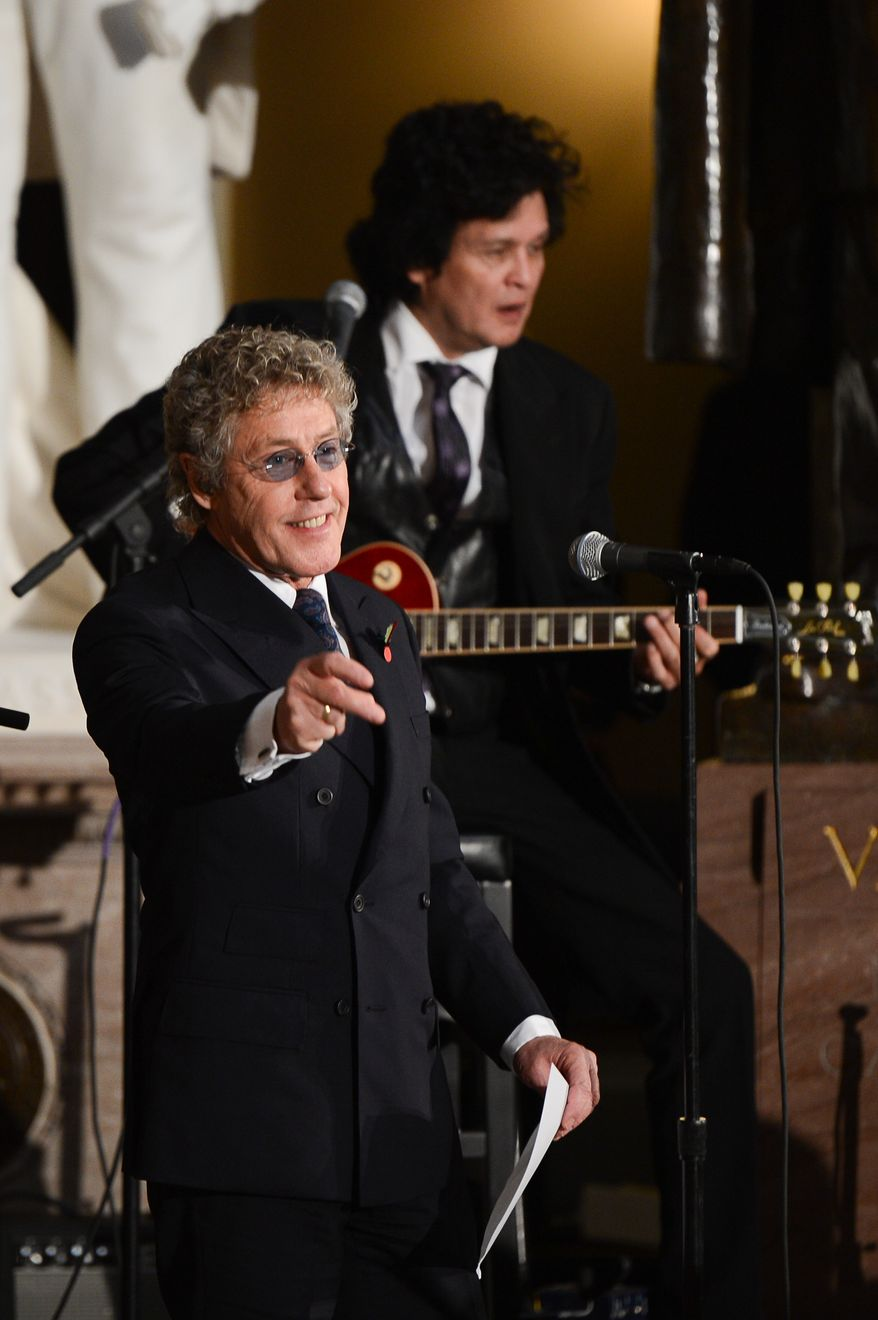 Roger Daltrey, lead singer of The Who performs during a dedication ceremony for former British Prime Minister Sir Winston Churchill in Statuary Hall of the U.S. Capitol Building, Washington, D.C., Wednesday, October 30, 2013. The bust was authorized and passed by the House of Representatives shortly before the 70th anniversary of Churchill's wartime address to a joint meeting of Congress. (Andrew Harnik/The Washington Times)