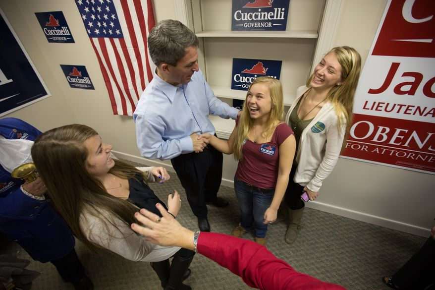 Anna Nunnelly, 17, from Glen Allen, VA., laughs as she shakes hands with Ken Cuccinelli during a campaign stop, in Glen Allen, VA., Wednesday, October 30, 2013.  (Andrew S Geraci/The Washington Times)