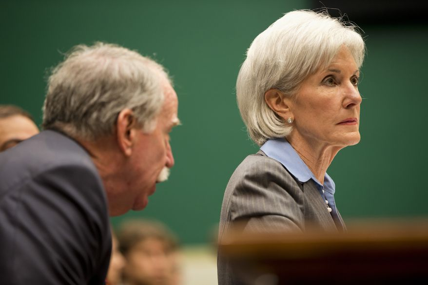 Health and Human Services Secretary Kathleen Sebelius listens to a member of her staff while testifying on Capitol Hill in Washington, Wednesday, Oct. 30, 2013, before the House Energy and Commerce Committee hearing on the difficulties plaguing the implementation of the Affordable Care Act.  Partisan sparks were flying in Congress on Tuesday as Sebelius, President Barack Obama's top health official apologized for wasting consumers' time as they tried to use the crippled website that allows them to buy government mandated health insurance under the overhaul known as Obamacare. (AP Photo/ Evan Vucci)