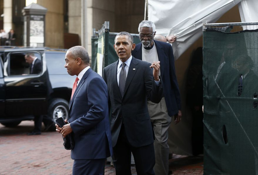 President Barack Obama emerges from a tent with Massachusetts Gov. Deval Patrick, left, and former Boston Celtics center Bill Russell, after he got a private viewing of a statue honoring Russell in Boston, Wednesday, Oct. 30, 2013. (AP Photo/Charles Dharapak)