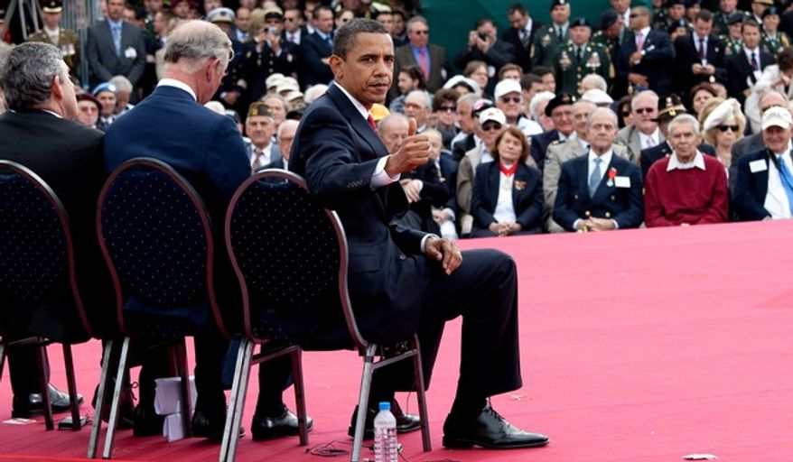 President Barack Obama gives a 'thumbs-up' to a group of World War II veterans sitting behind him on stage following his speech at the 65th anniversary of the D-Day invasion in Normandy, France, June 6, 2009. (White House photo)