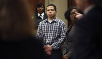 Eric Rivera, Jr. stands as the jury enters the courtroom for closing arguments at Rivera's trial Wednesday, Oct. 30, 2013. Rivera is accused of fatally shooting Washington Redskins star Sean Taylor during a failed 2007 burglary.  (AP Photo/The Miami Herald,Emily Michot, Pool )