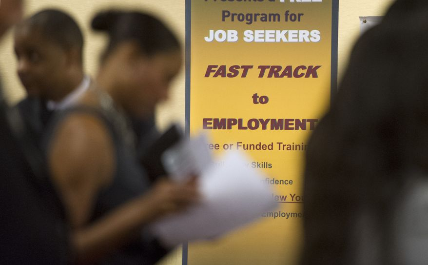 Job seekers line up to talk with recruiters during a job fair in Atlanta on Thursday, May 30, 2013. 