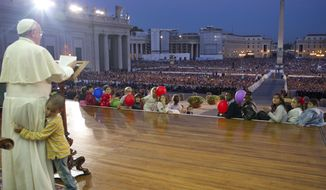 In this photo provided by the Vatican newspaper L'Osservatore Romano, a young boy, no name available, hugs Pope Francis as he delivers his speech during an audience with families in St. Peter's Square gathered for the Pontifical Council for the Familyís plenary assembly, at the Vatican, Saturday, Oct. 26, 2013. A young boy, part of a group of children sitting around the stage where the pontiff was delivering his message to families, played around Pope Francis as he continued delivering his speech, occasionally patting the boy's head.  (AP Photo/L'Osservatore Romano, ho)