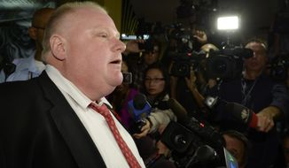 Mayor Rob Ford talks to media at City Hall in Toronto on Thursday, Oct. 31, 2013. (AP Photo/The Canadian Press, Frank Gunn)