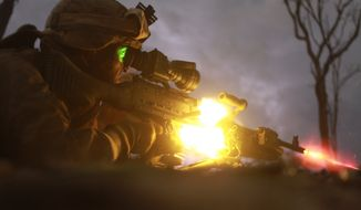 U.S. Marine Corps Pfc. Sebastian Rodriguez, a machine gunner with Weapons Platoon, Lima Company, 3rd Battalion, 3rd Marine Regiment, Marine Rotational Force-Darwin, fires an M240B machine gun during a night squad-attack exercise. (DoD photo by Sgt. Sarah Fiocco, U.S. Marine Corps/Released)
