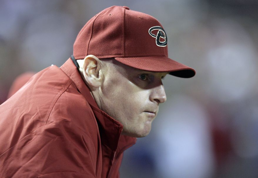 FILE - In this April 8, 2011 file photo, Arizona Diamondbacks coach Matt Williams watches a game against the Cincinnati Reds, in Phoenix. Williams is the new manager of the Washington Nationals. The Nationals will hold a news conference Friday, Nov. 1, 2013, to introduce Williams as the team's fifth manager since it moved to Washington from Montreal in 2005. He replaces Davey Johnson, who is retiring. (AP Photo/Paul Connors, File)