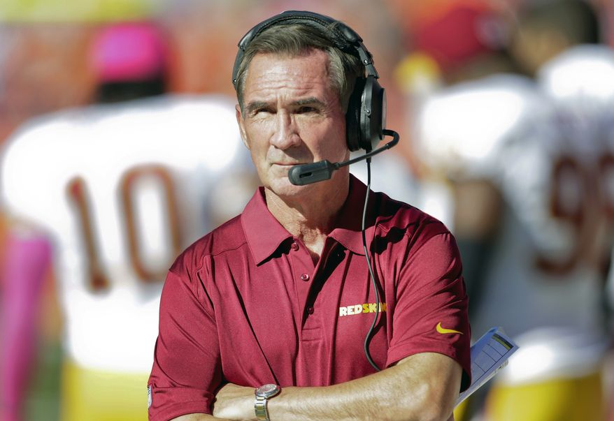 "FILE - In this Oct. 27, 2013, file photo, Washington Redskins coach Mike Shanahan watches a play from the sidelines against the Denver Broncos during an NFL football game in Denver. Shanahan leveled a scathing critique at Albert Haynesworth on Thursday, Oct. 31, saying the former Redskins defensive lineman was ""lazy"" and had a ""lack of passion"" and ""lack of character."" (AP Photo/Joe Mahoney, File)"