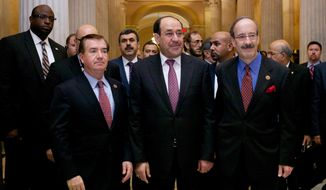 Iraqi Prime Minister Nouri al-Maliki (center) walks with Rep. Eliot L. Engel (right), New York Democrat, and Rep. Edward R. Royce, California Republican, on Capitol Hill in Washington on Wednesday, Oct. 30, 2013, before their meeting. Earlier, the prime minister met with Vice President Joseph R. Biden. (AP Photo/Molly Riley)