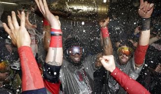 Boston Red Sox's David Ortiz celebrates with teammates after Game 6 of baseball's World Series against the St. Louis Cardinals Thursday, Oct. 31, 2013, in Boston. The Red Sox won 6-1 to win the series. Ortiz was names the series MVP. (AP Photo/David J. Phillip)