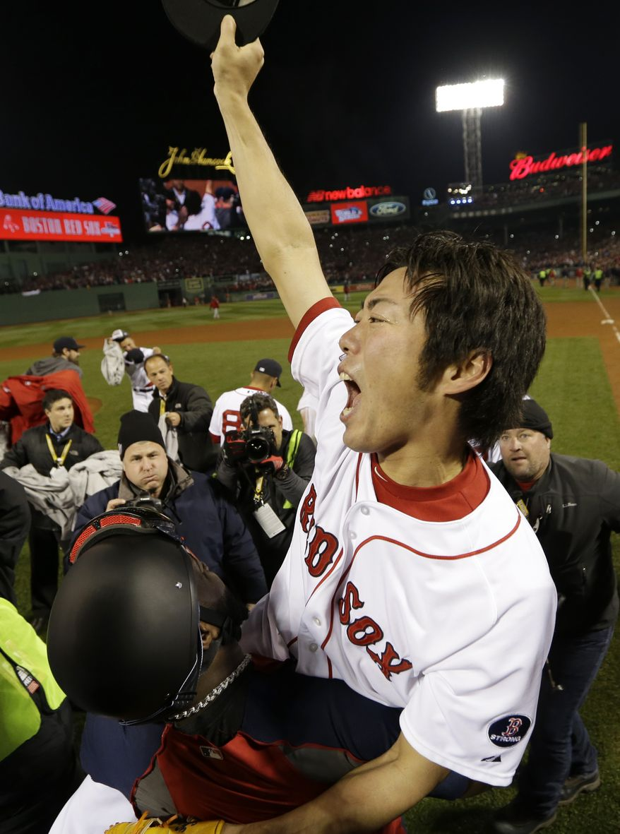 Boston Red Sox's David Ortiz carries relief pitcher Koji Uehara after winning Game 6 of baseball's World Series against the St. Louis Cardinals Wednesday, Oct. 30, 2013, in Boston. The Red Sox won 6-1 to win the series. (AP Photo/David J. Phillip)