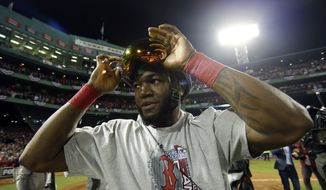 Boston Red Sox's David Ortiz adjust his goggles after Boston Red Sox defeated St. Louis Cardinals in Game 6 of baseball's World Series Wednesday, Oct. 30, 2013, in Boston. The Red Sox won 6-1 to win the series. (AP Photo/Matt Slocum)