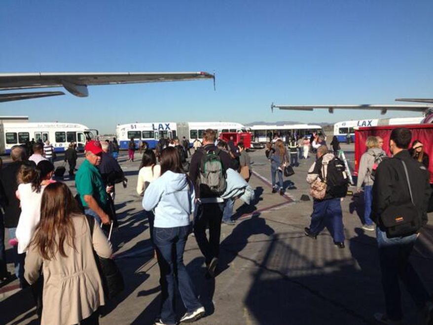 Passenger are evacuated from LAX terminals after shots were fired. Twitter:Tory Belleci@torybelleci