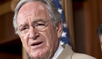 FILE - In this July 18, 2013 file photo, Sen. Tom Harkin, D-Iowa speaks on Capitol Hill in Washington. Harkin is one of many proponents of a bill that would prohibit employers from discriminating against workers on the basis of sexual orientation or gender identity. (AP Photo/J. Scott Applewhite, File)