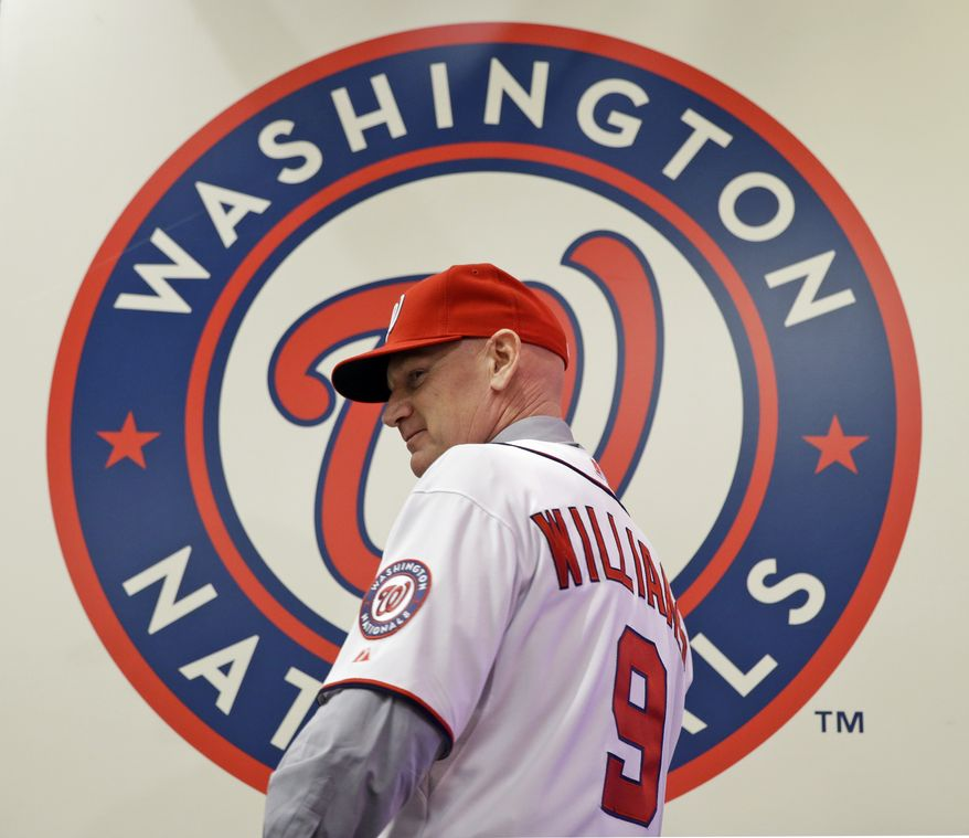 Matt Williams turns after showing the back of his newly-donned jersey, after he is introduced as the new manager of the Washington Nationals baseball team, during a news conference at Nationals Park, Friday, Nov. 1, 2013, in Washington. (AP Photo/Alex Brandon)