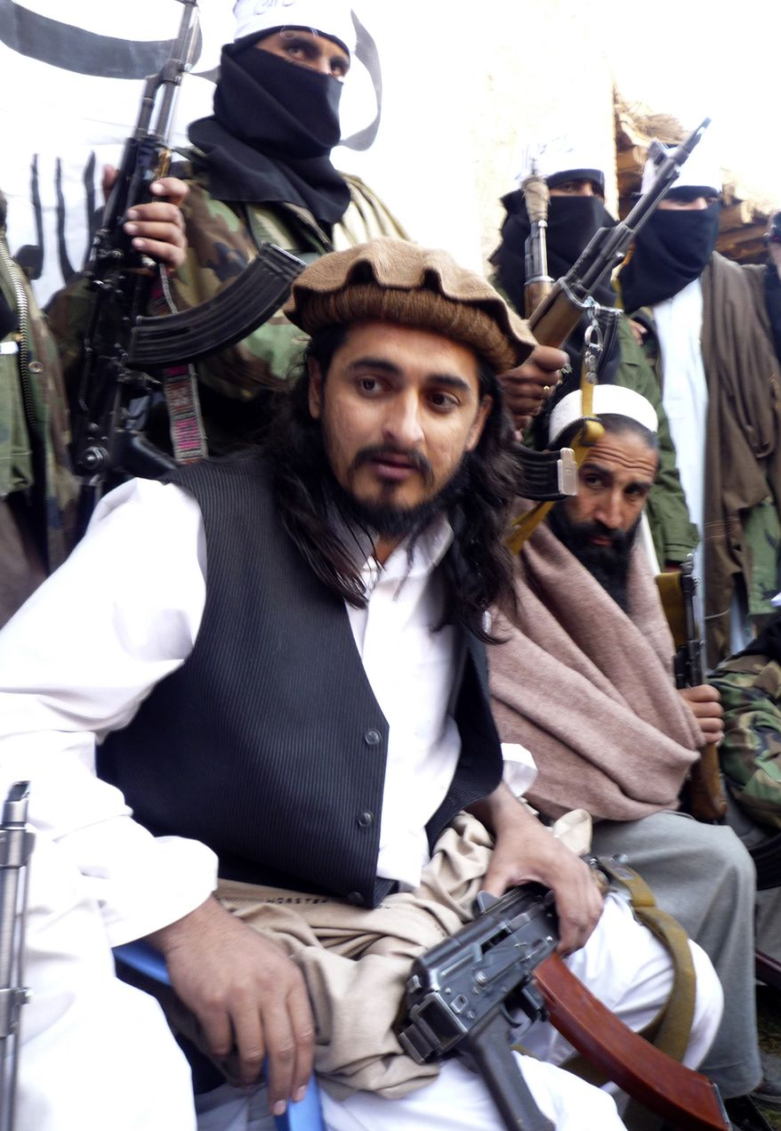 FILE - In this file image taken on Nov. 26, 2008, Hakimullah Meshud, then the deputy Pakistani Taliban leader, is flanked by his comrades in Orakzai tribal region of Pakistan. Intelligence officials said Friday, Nov. 1, 2013 that the leader of the Pakistani Taliban Hakimullah Mehsud was one of three people killed in a U.S. drone strike.  (AP Photo/Ishtiaq Mehsud)
