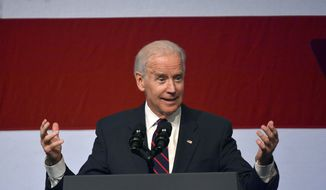 Vice President Joe Biden delivers the keynote and honors his former Senate colleague of more than 20 years, Senator Jay Rockefeller, at the annual Jefferson-Jackson Dinner at the Charleston Civic Center. W.Va. on Saturday, Nov. 2, 2013. (AP Photo/Tyler Evert)