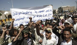"""Supporters of an Islamic Salafi movement chant slogans during a demonstration to denounce shelling at district in Damaj, in Saada province by Houthi rebels, in Sanaa, Yemen, Saturday, Nov. 2, 2013. A spokesman of an Islamic Salafi movement said Thursday, Oct. 31, that at least 30 people have been killed in clashes with northern rebels in two days, an escalation of fighting in the country's restive north. Arabic writing on a banner reads, """"O President, O reconciliation government, Damaj wound bleeding from the blood of Yemenis, is it your responsibility to stop this bleeding?"""" (AP Photo/Hani Mohammed)"""
