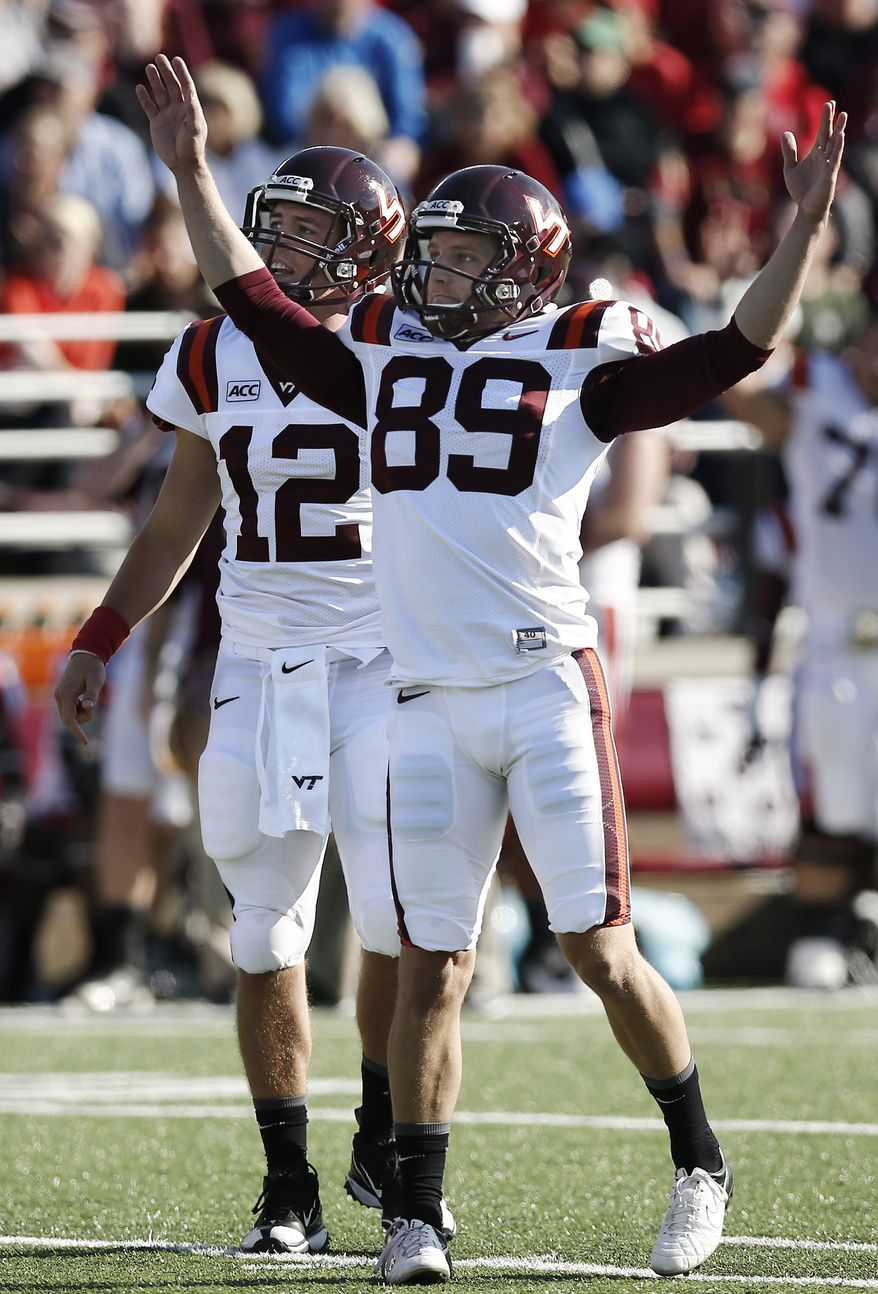 Virginia Tech place kicker Cody Journell (89) celebrates his 56-yard field goal against Boston College during the first half of an NCAA college football game at Alumni Stadium in Boston, Saturday, Nov. 2, 2013. (AP Photo/Winslow Townson)
