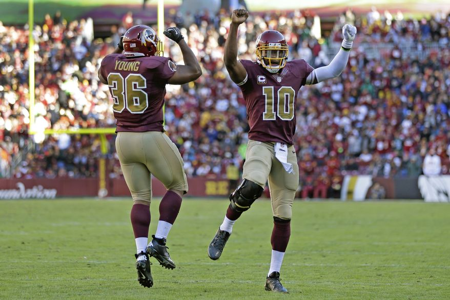 Washington Redskins fullback Darrel Young celebrates his touchdown with quarterback Robert Griffin III, right, during the second half of a NFL football game against San Diego Chargers in Landover, Md., Sunday, Nov. 3, 2013. (AP Photo/Patrick Semansky)