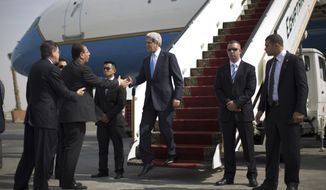 Secretary of State John F. Kerry arrives in Cairo on Sunday, Nov. 3, 2013, where he will press Egypt for reforms during the highest-level American visit to the country since the ouster of that nation's first democratically elected president, Mohammed Morsi, in July. (AP Photo/Jason Reed, Pool)