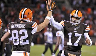 Cleveland Browns quarterback Jason Campbell (17) celebrated with tight end Gary Barnidge (82) after they hooked up on a 4-yard touchdown pass against the Baltimore Ravens in the third quarter of an NFL football game Sunday, Nov. 3, 2013. (AP Photo/David Richard)