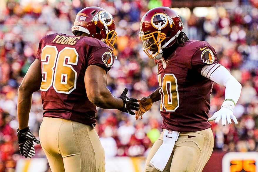 Washington Redskins quarterback Robert Griffin III (10), right, celebrates with Washington Redskins fullback Darrel Young (36) after he scores on a 1 yard run play in the third quarter as the Washington Redskins play the San Diego Chargers at FedExField, Landover, Md., Sunday, November 3, 2013. (Andrew Harnik/The Washington Times)
