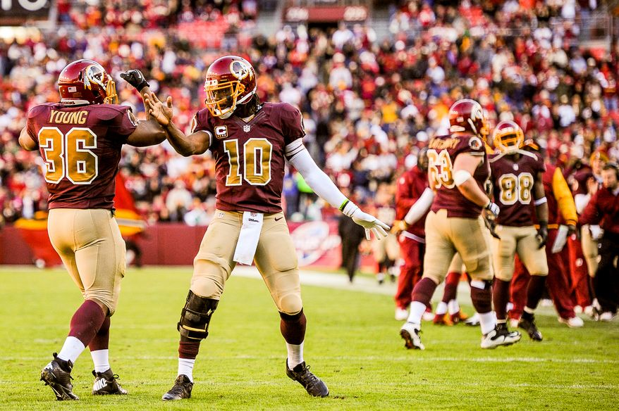 Washington Redskins quarterback Robert Griffin III (10), second from left, celebrates with Washington Redskins fullback Darrel Young (36), left, after he scores on a 1 yard run play in the third quarter as the Washington Redskins play the San Diego Chargers at FedExField, Landover, Md., Sunday, November 3, 2013. (Andrew Harnik/The Washington Times)