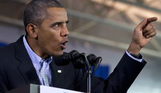 ** FILE ** President Obama gestures while speaking at an event at Washington-Lee High School in Arlington, Va. on Nov. 3, 2013. (AP Photo/Jacquelyn Martin)